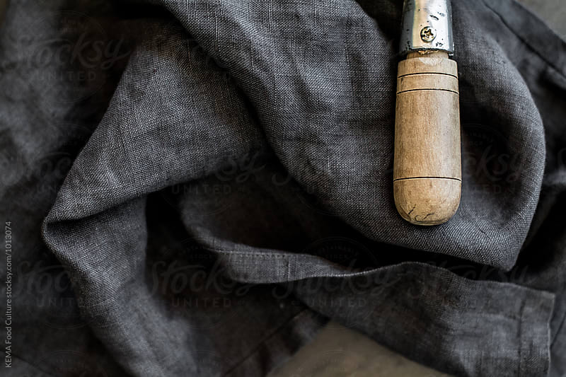 Panhandle on a grey linen fabric napkin by KEMA Food Culture for Stocksy United