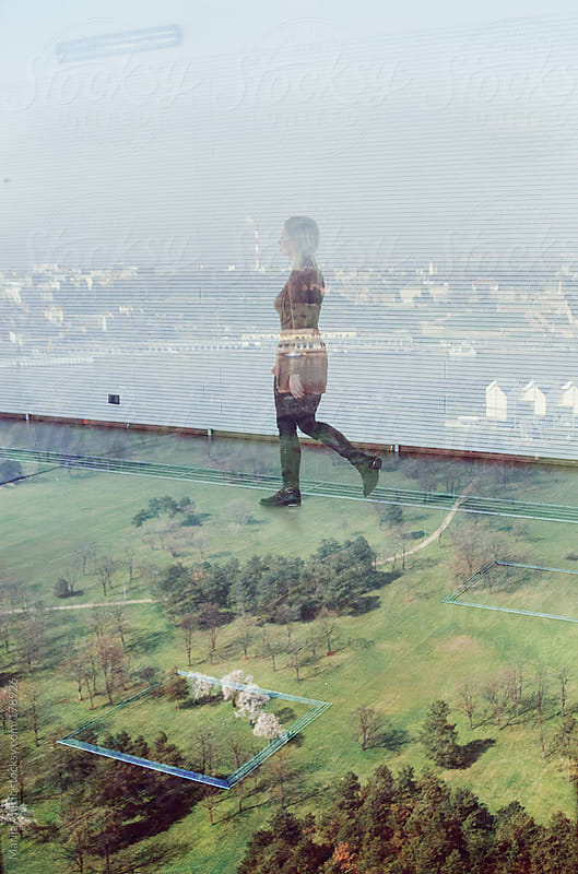 Walking on air,reflection in glass by Marija Anicic for Stocksy United