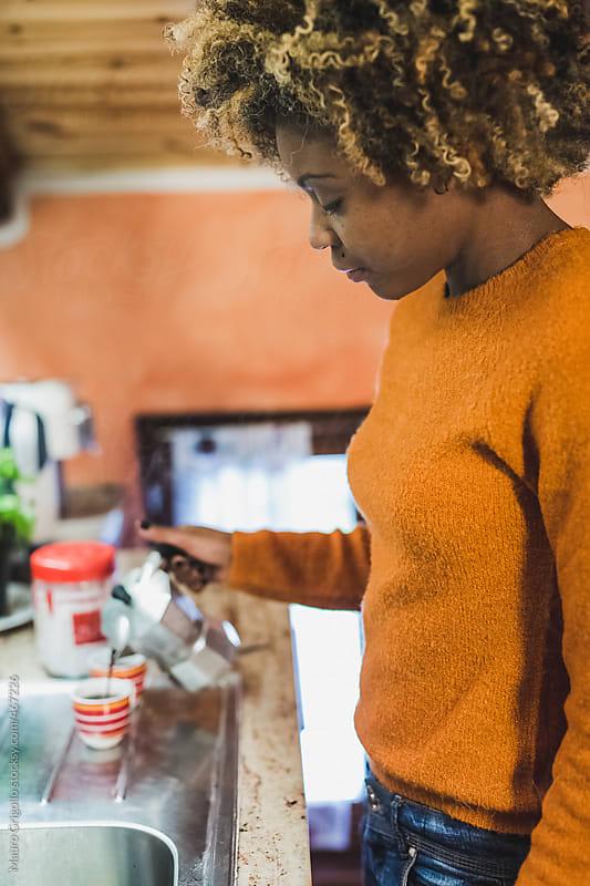 Woman preparing coffee at home by Mauro Grigollo for Stocksy United