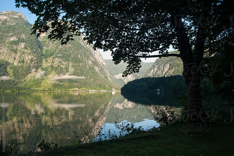 Hallstatt lake at dawn. by Gergely Kishonthy for Stocksy United
