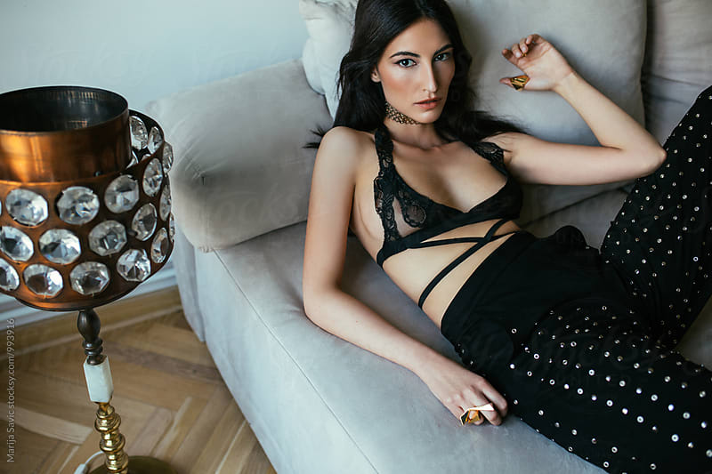 Sexy Woman Lying on Sofa by Marija Savic for Stocksy United
