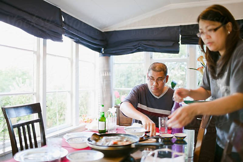Head of the Family- Husband and Wife Preparing for Dinner by Joselito Briones for Stocksy United