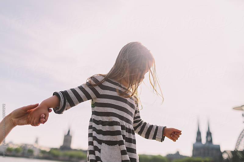 Little girl walkin above  by Evgenij Yulkin for Stocksy United