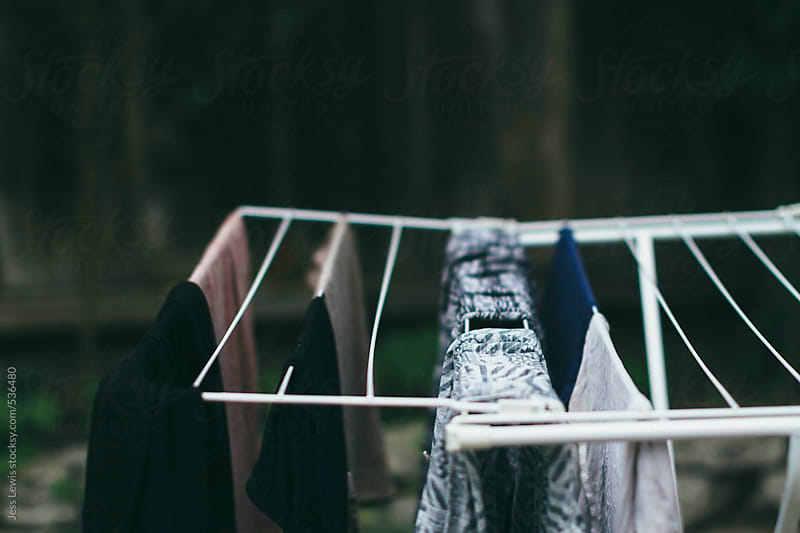 laundry drying on clothing rack by Jess Lewis for Stocksy United