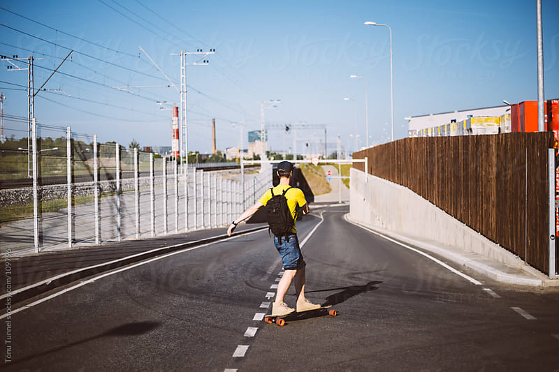 Cruising on a longboard by Tõnu Tunnel for Stocksy United