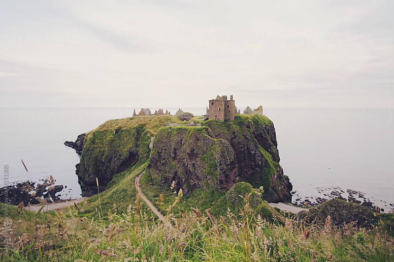 Ruined Donnatar Castle's seaside cliff landscape, Northern Scotland. by Kaat Zoetekouw for Stocksy United