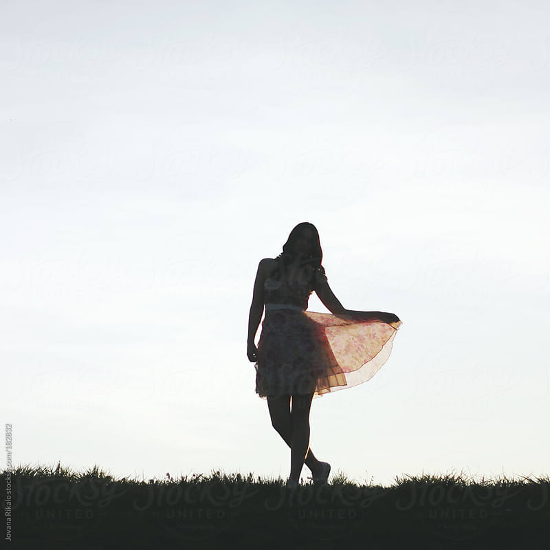 Silhouette of a young woman in nature by Jovana Rikalo for Stocksy United