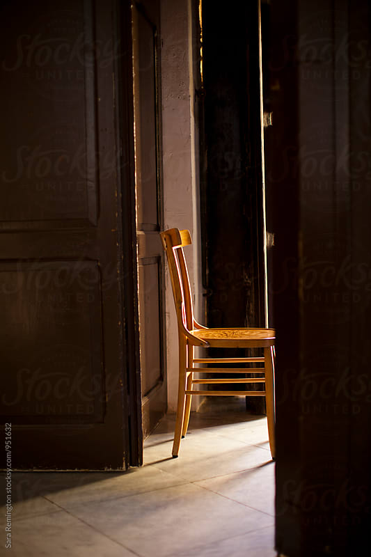 Wood Chair in Church Doorway by Sara Remington for Stocksy United