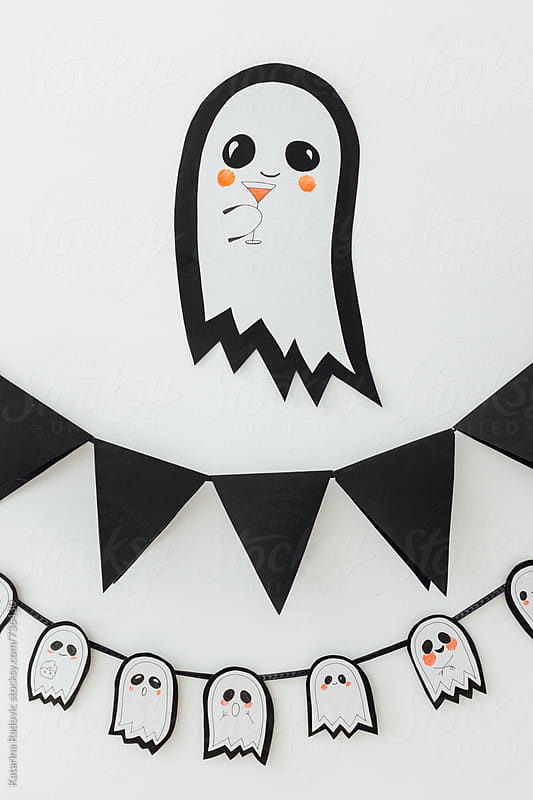 Cute Halloween Ghost on the Wall by Katarina Radovic for Stocksy United