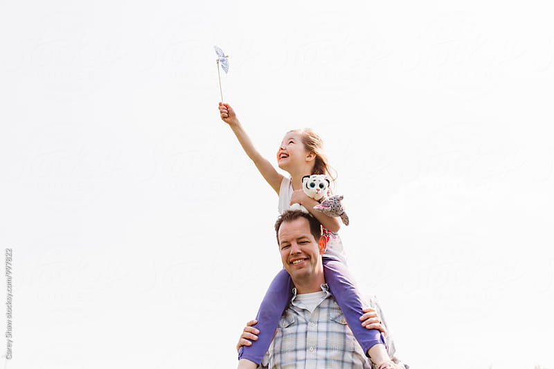 Young daughter sitting on fathers shoulders by Carey Shaw for Stocksy United