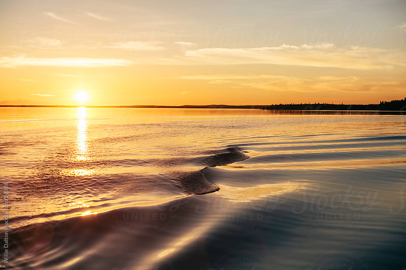 Waves on a Lake During Sunset by Willie Dalton for Stocksy United