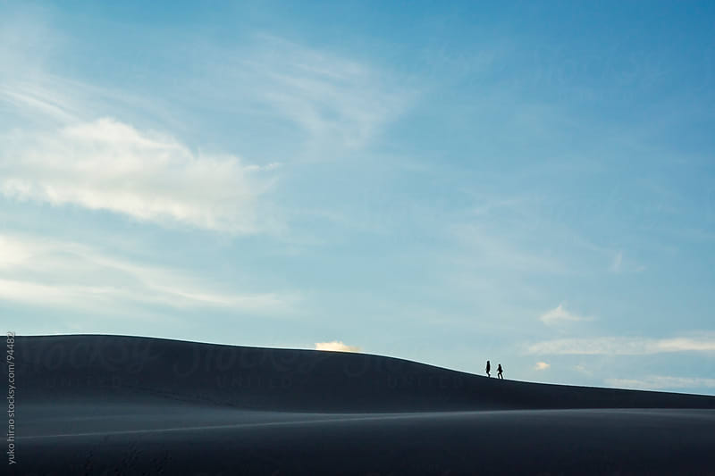 Hikers on sand dunes at desert by yuko hirao for Stocksy United