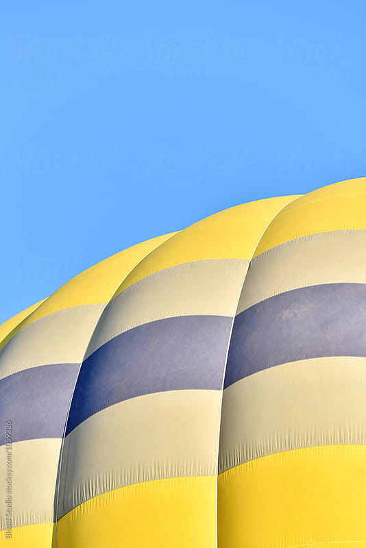 Close up detail of a yellow hot air balloon by Bisual Studio for Stocksy United