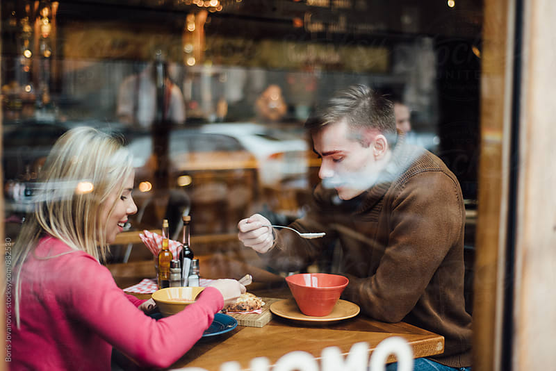 Couple having a lunch in the restaurant by Boris Jovanovic for Stocksy United