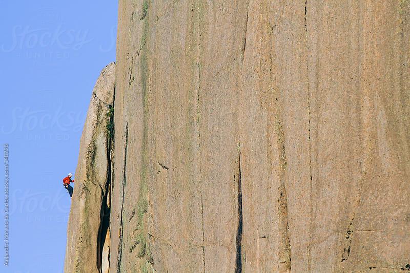 Climber on big rock vertical wall by Alejandro Moreno de Carlos for Stocksy United