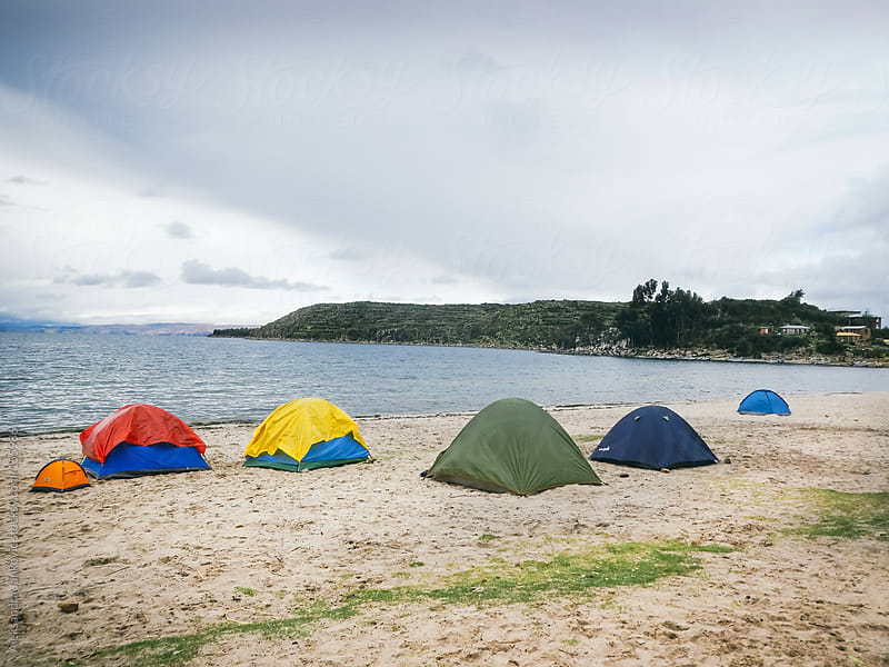 Colourful tents on the beach by Aleksandra Jankovic for Stocksy United