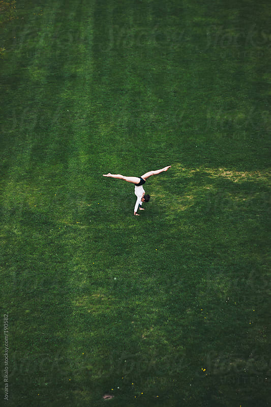 Young woman practicing yoga outdoors by Jovana Rikalo for Stocksy United