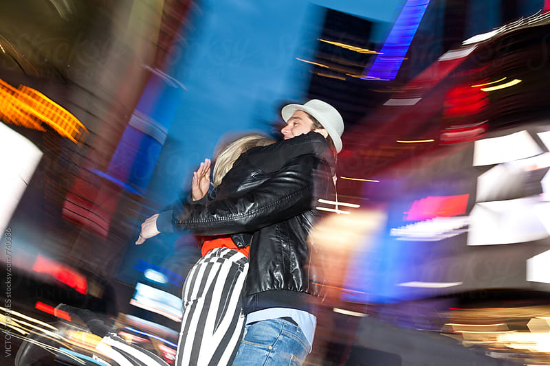Couple Hugging in the Street at Night by Victor Torres for Stocksy United