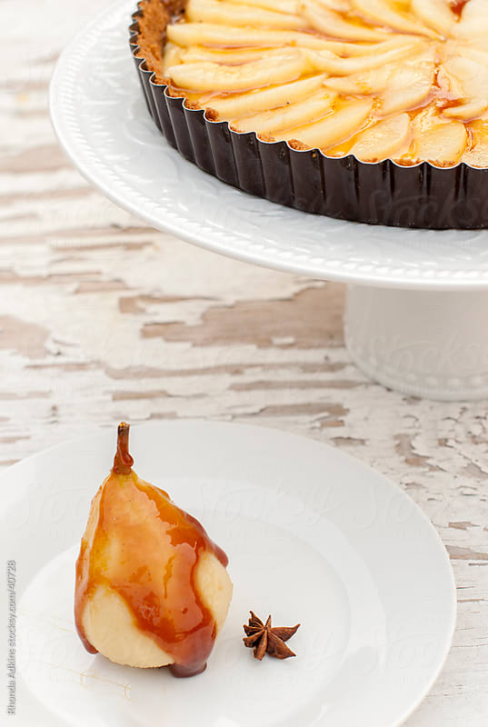 Pear tart with a caramelized poached pear by Rhonda Adkins for Stocksy United