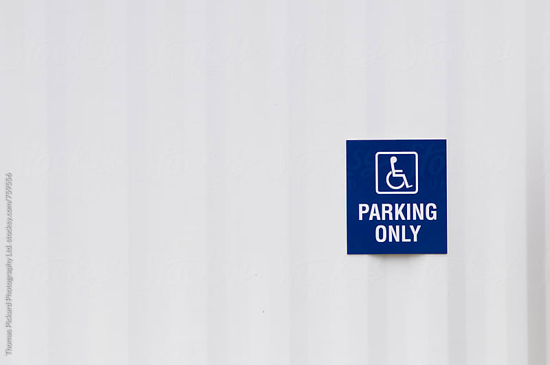 Disable Parking Sign against a white container, Christchurch, New Zealand. by Thomas Pickard for Stocksy United
