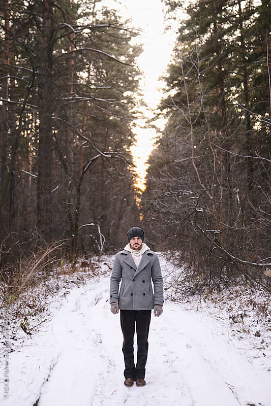Portrait of lonely bearded man standing in winter forest by T-REX & Flower for Stocksy United