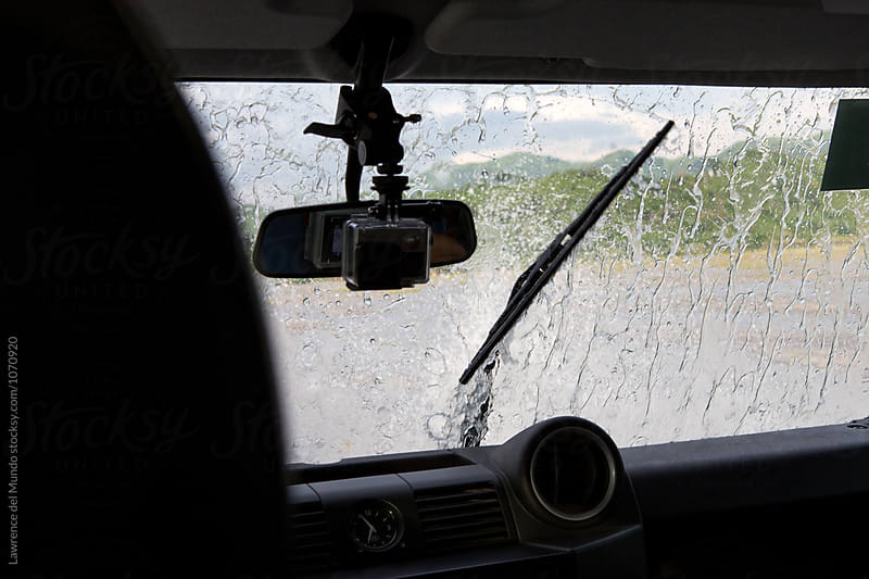 Water splashed windshield of a 4 x 4 off-road vehicle. by Lawrence del Mundo for Stocksy United