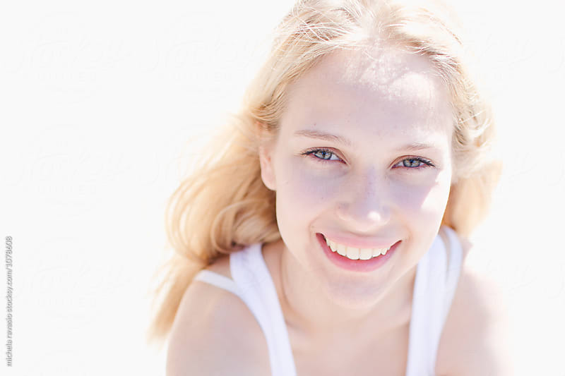 Portrait of smiling blond girl by michela ravasio for Stocksy United