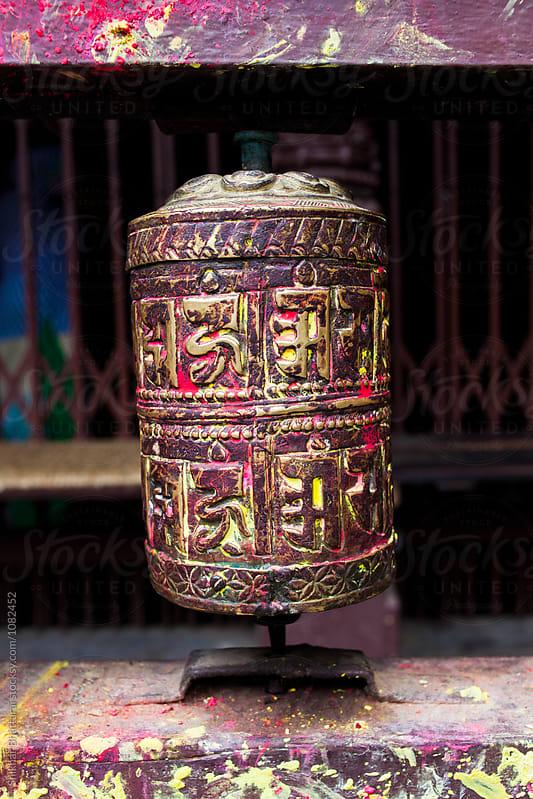 close up of a colorful prayer wheel in Kathmandu. by Shikhar Bhattarai for Stocksy United