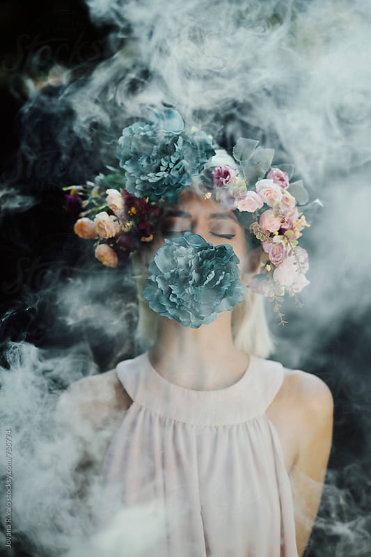 Artistic portrait of a young woman with smoke bomb by Jovana Rikalo for Stocksy United