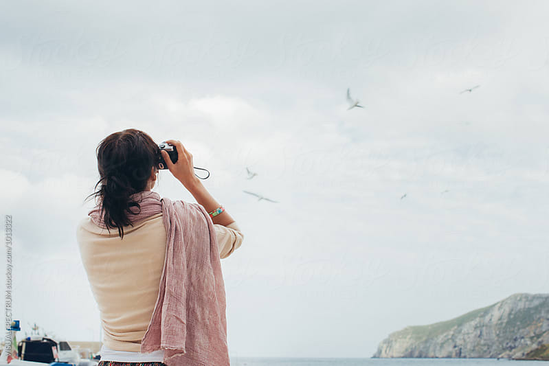 Female Photographer Shooting Seagulls With Analog Camera by VISUALSPECTRUM for Stocksy United