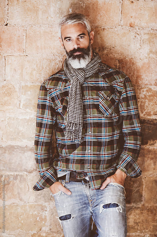 i his thirties: handsome and bearded man posing by Guille Faingold for Stocksy United