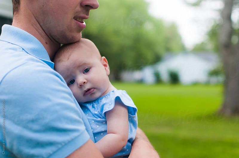A father holding his baby  by Chelsea Victoria for Stocksy United