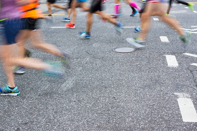 A crowd of runners in motion by yuko hirao for Stocksy United