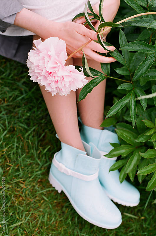 Rubber boots and pink peony by Lyuba Burakova for Stocksy United