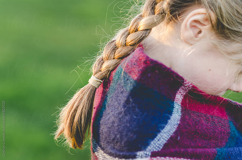 Pigtails in sunlight by Lindsay Crandall for Stocksy United