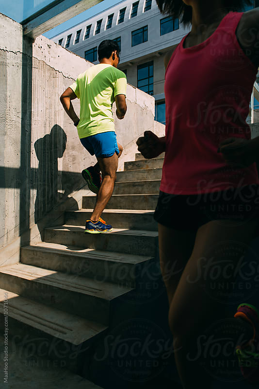 Young man and woman running by MaaHoo Studio for Stocksy United