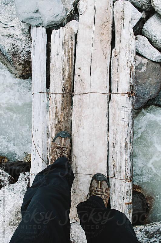 Male trekker crossing a wooden bridge, Everest Region, Sagarmatha National Park, Nepal. by Thomas Pickard for Stocksy United