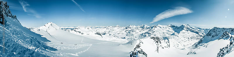 panoramashot of the austrian alps in winter by Leander Nardin for Stocksy United