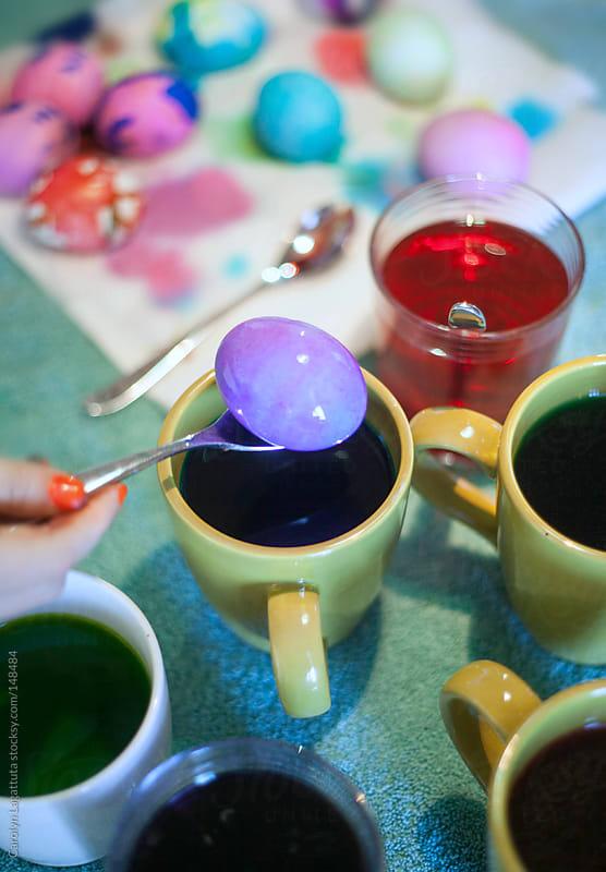 Coloring Easter eggs by Carolyn Lagattuta for Stocksy United