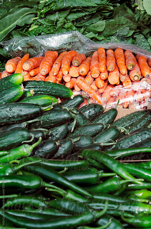 Cucumbers,hot green peppers and mangolds on the market by Marija Anicic for Stocksy United