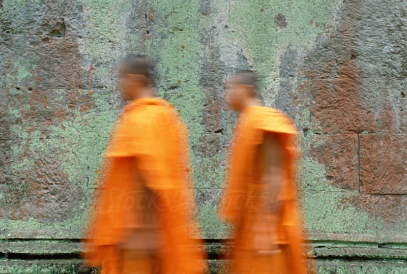 Khmer Buddhist monks at Ta Prohm Temple, Angkor, Seim Reap, Cambodia, South East Asia by Gavin Hellier for Stocksy United