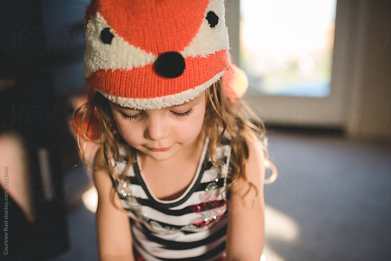 Girl looking down in fox hat by Courtney Rust for Stocksy United