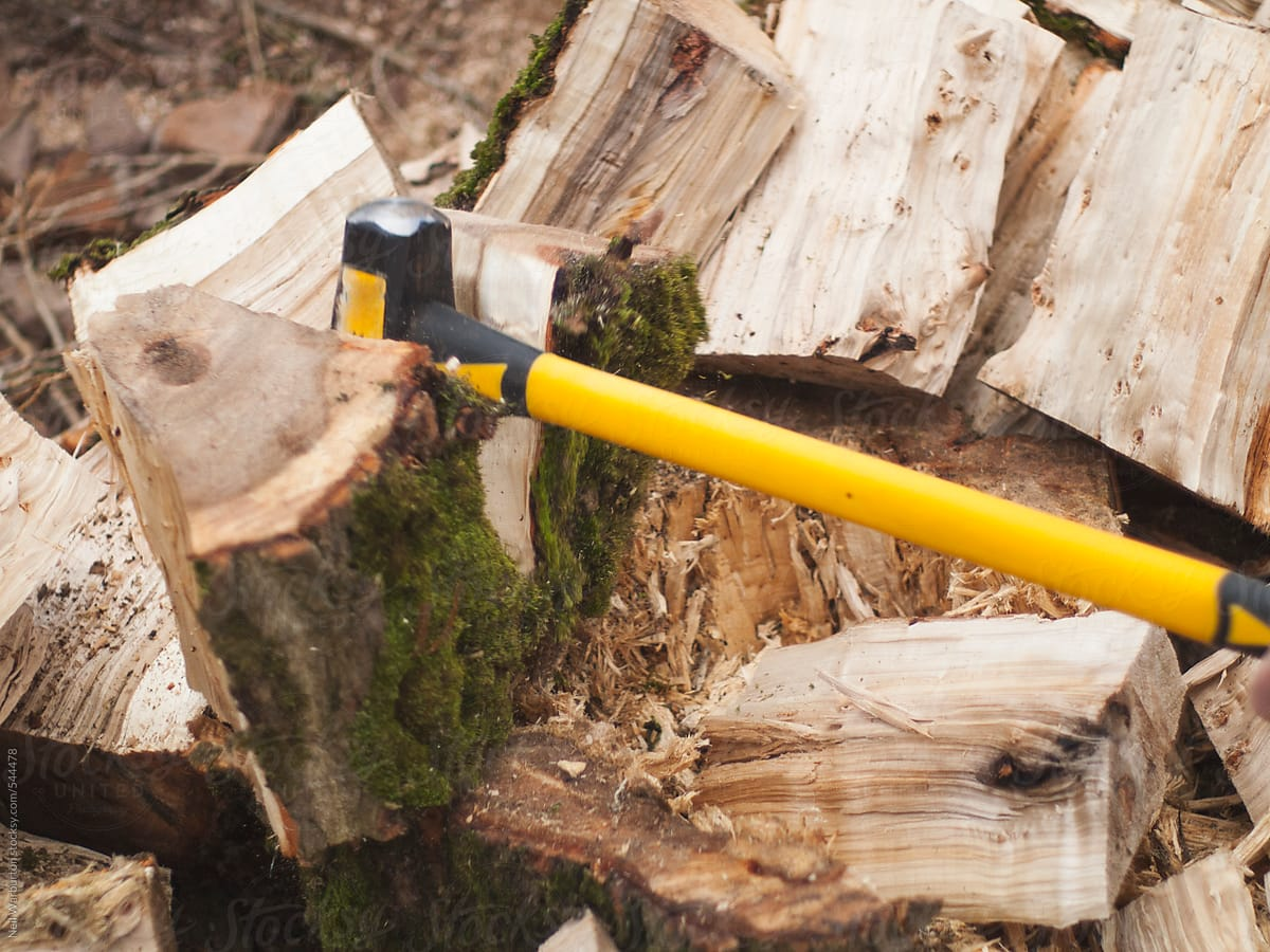 Splitting Wood With An Axe Stocksy United