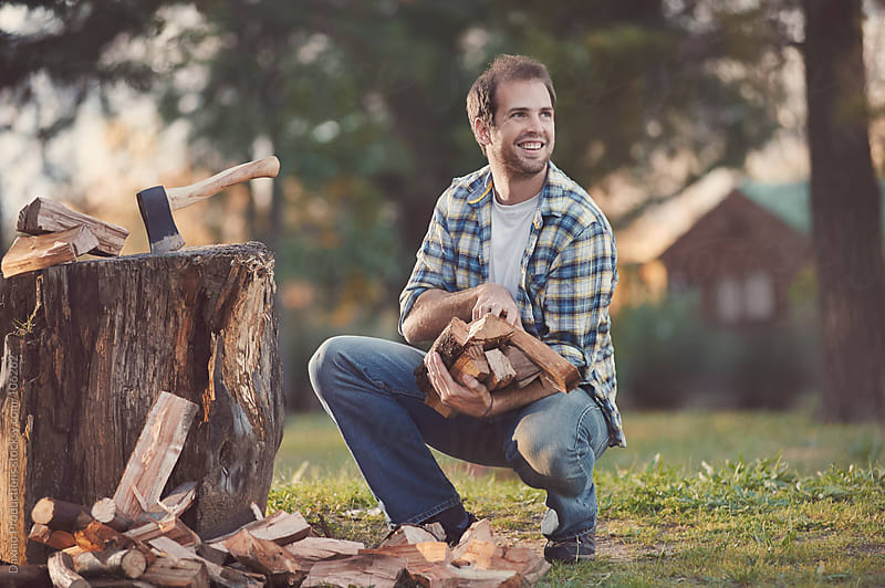 happy firewood man by Daxiao Productions for Stocksy United