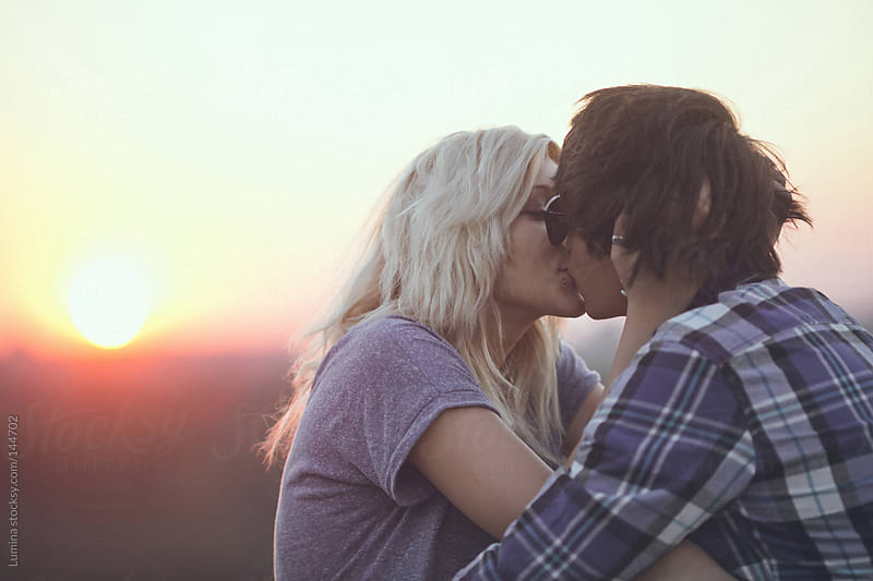 Couple Kissing in the Sunset by Lumina for Stocksy United