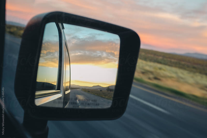 Sunset in a moving car mirror by Micky Wiswedel for Stocksy United