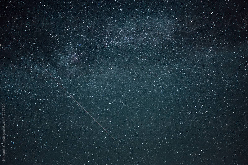 Starry Sky With Airplane and Satellite Linear Trails by Nemanja Glumac for Stocksy United