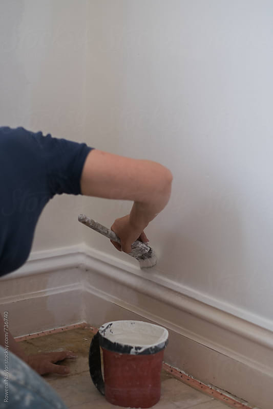 Painting an interior wall by Rowena Naylor for Stocksy United