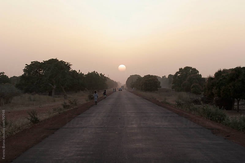 Road to the dusty Sunset in Mali, Africa by Ferenc Boros for Stocksy United