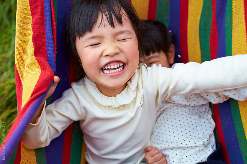 two lovely little asian girl having fun outdoor by cuiyan Liu for Stocksy United